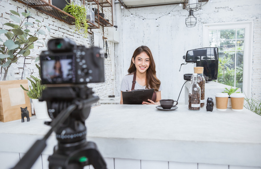 Small business owner filming her video marketing
