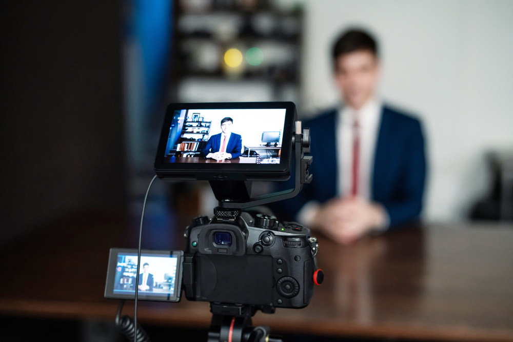 Lawyer recording a video (5 Simple Video Marketing Tips for Lawyers and Law Firms)